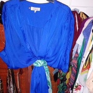 Bright blue women flowering blouse.